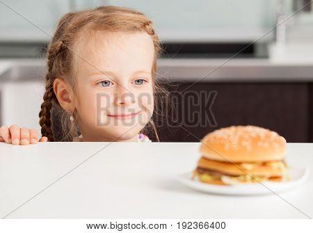 Child looking at  hamburger