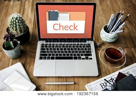 Illustration of personal organizer notepad on laptop