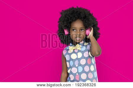 Little Girl Listening Music Headphones Studio Portrait