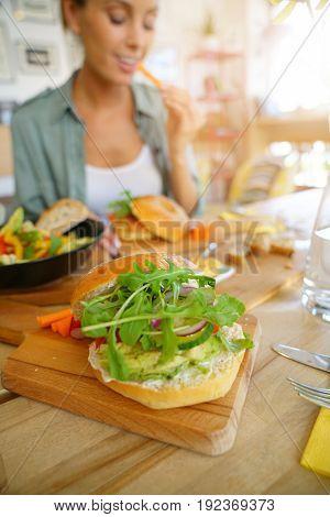 Closeup of veggie bagel set on restaurant table