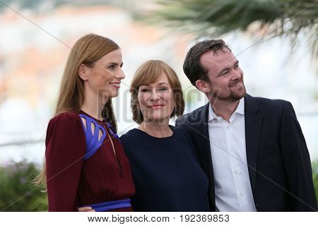 Janine Jackowski, Valeska Grisebach and Jonas Dornbach attend 'Western' Photocall during the 70th annual Cannes Film Festival at Palais des Festivals on May 18, 2017 in Cannes, France.