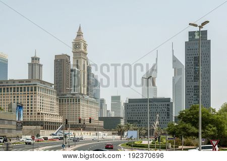 DUBAI, UAE - CIRCA AUGUST 2016:Busy day street with skyscrapers, urban architecture of Arab city - Dubai, UAE
