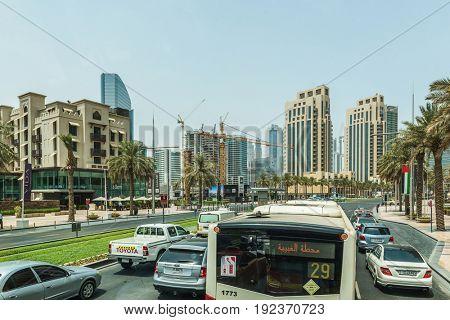 DUBAI, UAE - CIRCA AUGUST 2016:Stuck in Traffic on Multi Lane Street Through Modern Downtown Neighborhood with Contemporary Architecture on Sunny Day, Dubai, United Arab Emirates