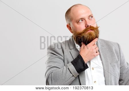 Brutal man holds his beard