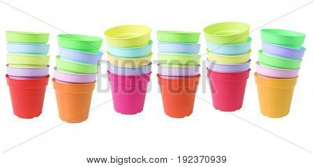 Row of Colourful Plastic Flower Pots on White Background