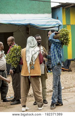 HARAR, ETHIOPIA-MARCH 26, 2017: Unidentified people buy and sell Khat, a drug common in East Africa