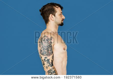 Adult man with tattoo bare chest