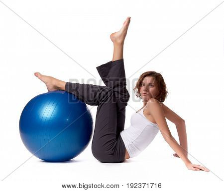 Young  beautiful woman with gymnastic ball on a white background.