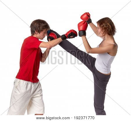 Sporty couple in red fighting gloves on a white background.