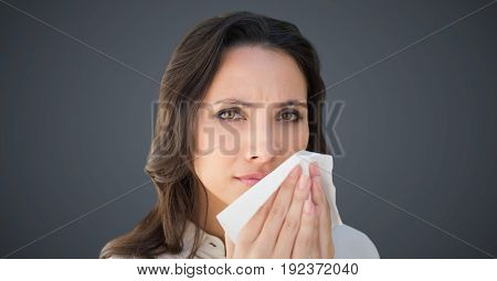 Digital composite of Close up of woman with tissue against grey background