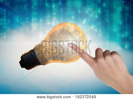 Digital composite of Hand Touching Light bulb fingerprint