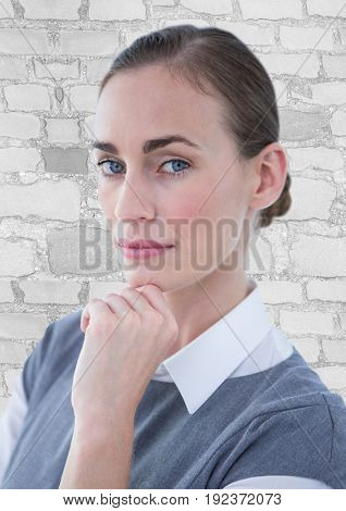 Digital composite of Close up of business woman thinking against white brick wall