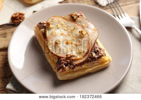 Plate with delicious pastry and flatware, closeup