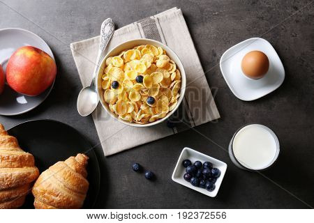 Healthy breakfast with corn flakes on table
