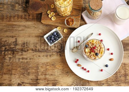 Healthy breakfast with muesli and berries on wooden table