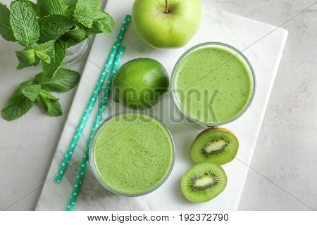Delicious yogurt smoothie with apple and kiwi on light table