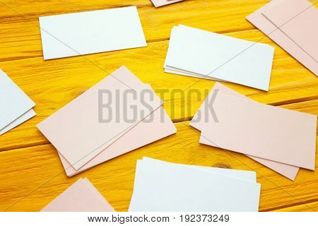 Blank business cards on color wooden background