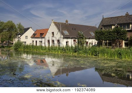 Houses on the river Graafstroom in the small hamlet Gijbeland in the Dutch region Alblasserwaard