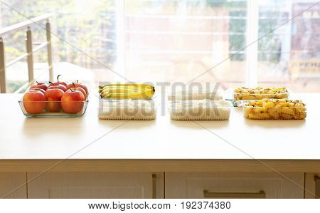 Table with different products near window. Volunteering concept