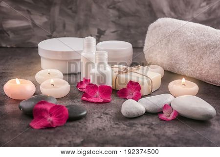 Beautiful composition of cosmetics with hortensia flowers on dark background