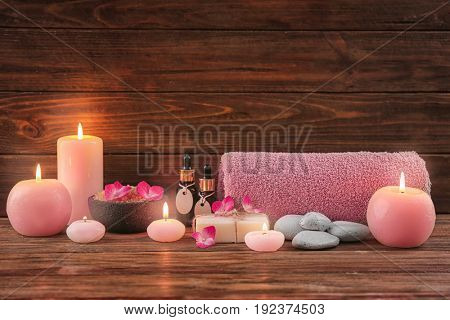Beautiful composition of cosmetics with hortensia flowers on brown wooden background