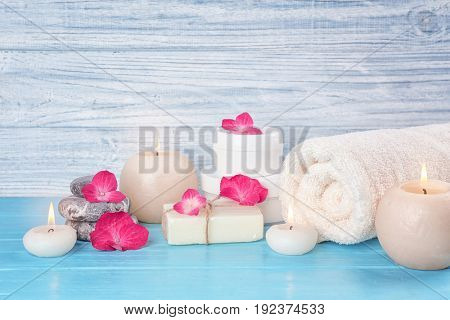 Beautiful composition of cosmetics with hortensia flowers on wooden background