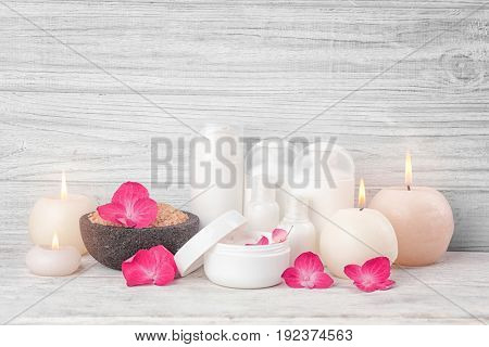 Beautiful composition of cosmetics with hortensia flowers on white wooden background
