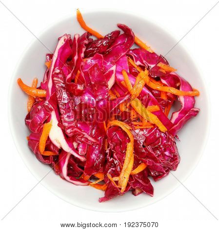 Red Cabbage Cole Slaw with Red Wine Vinegar and Carrots in a white bowl over white.