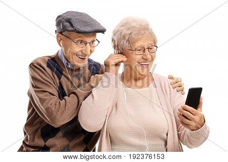 Elderly couple listening to music on a phone together isolated on white background