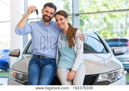 Young couple buying a car