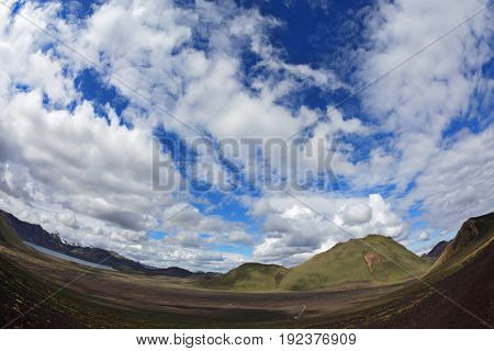 Iceland in July. Great Valley Park Landmannalaugar, surrounded by mountains of rhyolite and unmelted snow. Trend