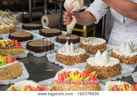 Manual cakes production on factory
