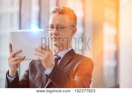 Businessman looking at digital tablet in office