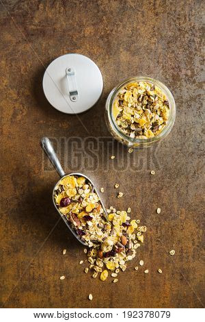 Tasty homemade muesli with nuts in scoop. Top view.