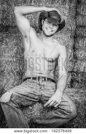 Smiling cowboy with six pack abs