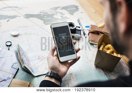 Young guy traveler planning the trip for vacation