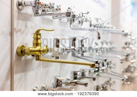 Water faucets on the shelf closeup, plumbing shop