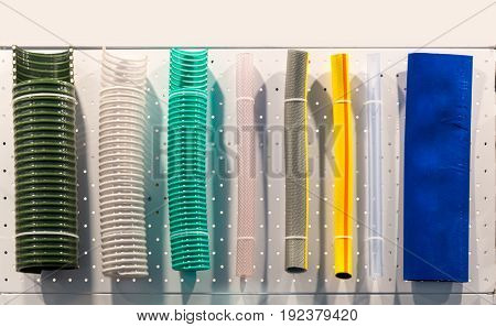 Corrugated plastic tubes and rubber water hoses