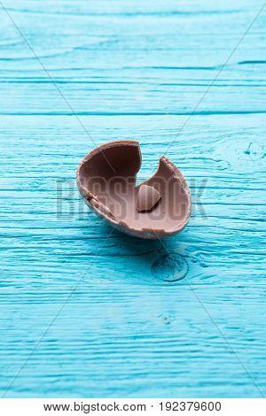 Half chocolate egg, blue table