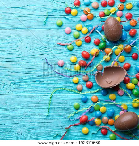 Multicolored sweets, chocolate eggs, ribbons