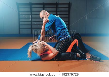 Woman fights with man, self-defense technique