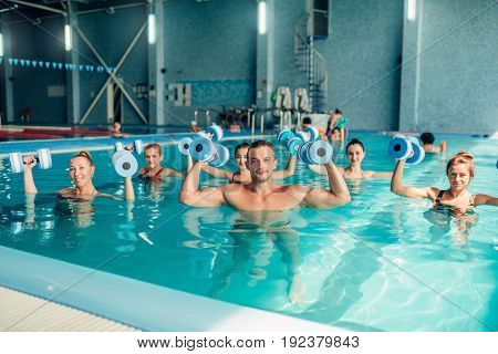 Group aqua aerobics traninig in indoor pool