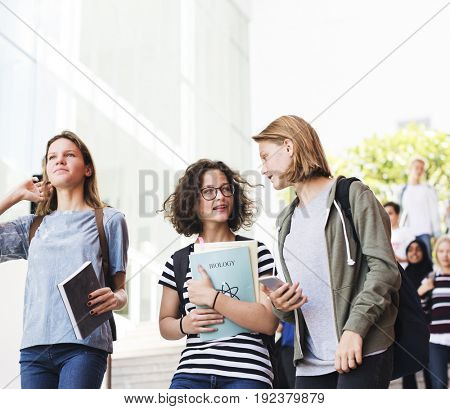Group of students walking in the school