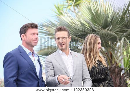 Taylor Sheridan, Jeremy Renner and Elizabeth Olsen attend the 'Wind River' photocall during the 70th annual Cannes Film Festival at Palais des Festivals on May 20, 2017 in Cannes, France.