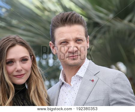 Elizabeth Olsen and Jeremy Renner attend the 'Wind River' photocall during the 70th annual Cannes Film Festival at Palais des Festivals on May 20, 2017 in Cannes, France.