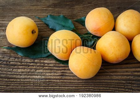 Apricots With Leaves On The Old Wooden Table