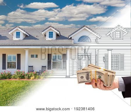Hand Holding Stack of Money Over House Drawing Gradating Into Photograph.