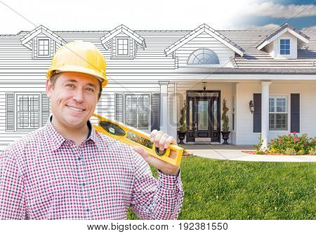 Male Contractor Wearing Hard Hat In Front of House Drawing Gradation Into Photograph.
