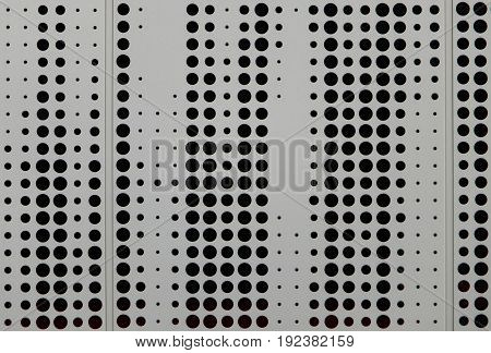 grey metal cladding with circular perforated design