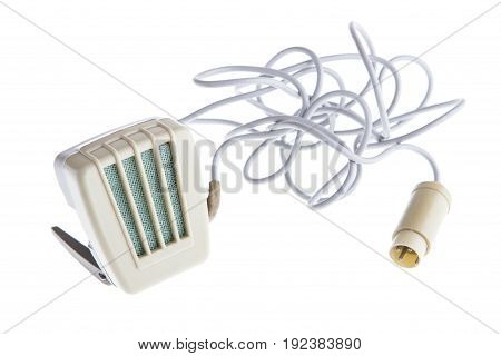 Old plastic retro microphone and cable isolated on white background